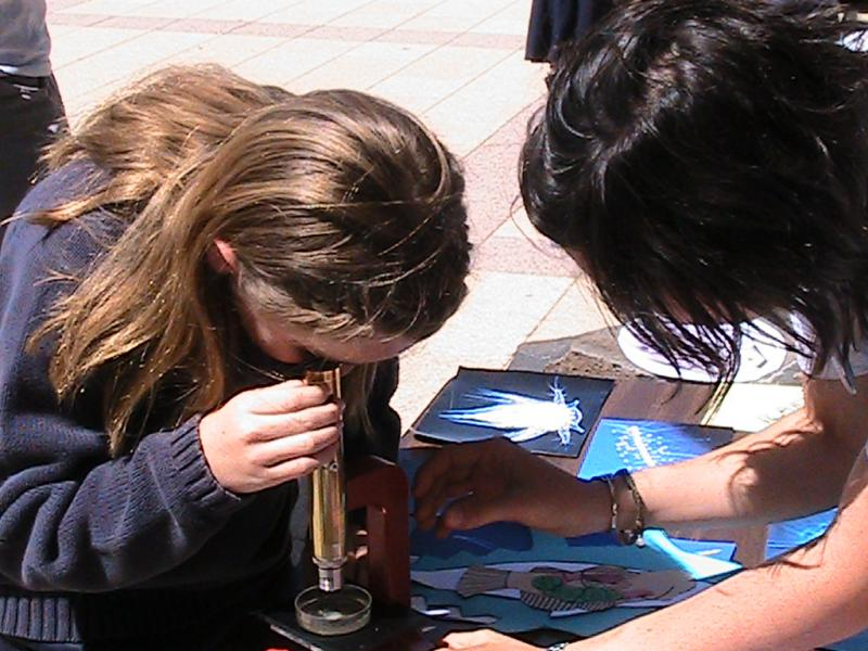 child using microscope