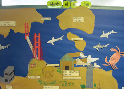 Student-made wall map with ocean and land