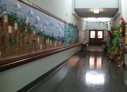 Long hallway full of Ocean art work